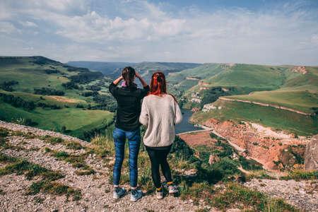 Two girls looking at mountian de guia from Balc es viewpoint in de Faial Area