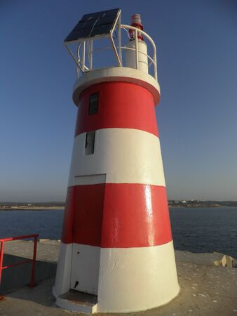 port lighthouse at the end of the breakwater