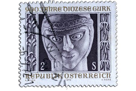 closeup image of postal stamp which old sculpture as motiv