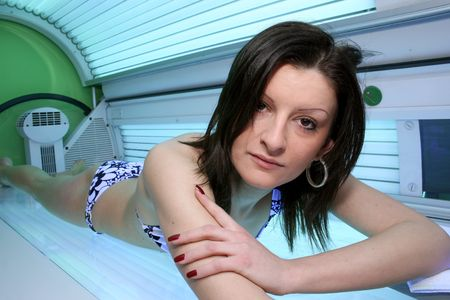 image of beautiful girl that sunbathing on solarium