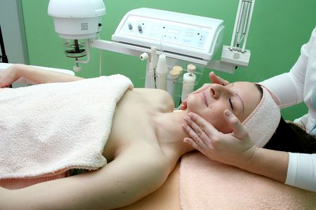 image of beauty young girl which enjoying face massage