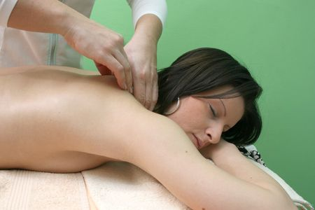image of nice girl that takes neck massage