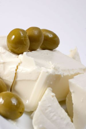 closeup image of couple olives on cheese