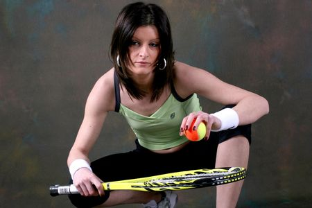 image of nice athletic girl whit tenis equipment