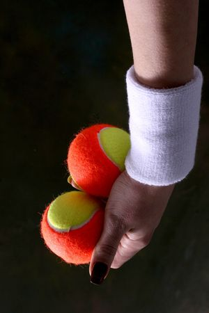 image of one arm with two tenis balls