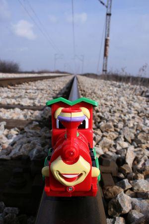 image of one toy locomotive on realy railway Stock Photo