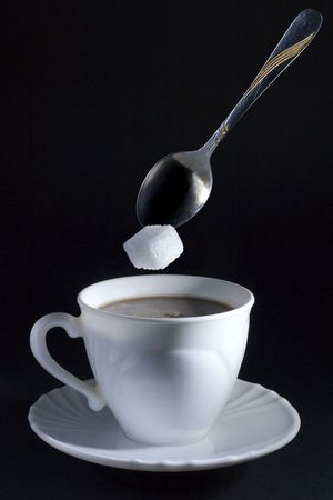 closeup image of coffe cup with sugar cube