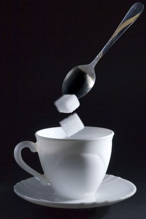 action image with two sugar cubes that falling on cup Stock Photo