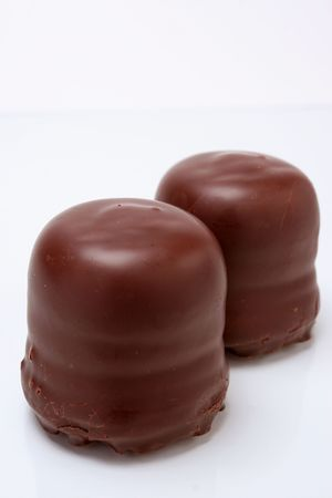 closeup image of two sweet candies with chocolate