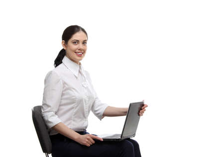 assistent: the portrait of smiling beautiful business woman sitting on the office chair and holding laptop in her arms