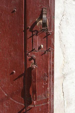 weatherworn: red door Stock Photo