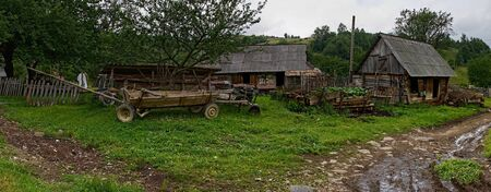 Traditional carpathian homestead, wooden barn and horse-drawn cart, Ukraine