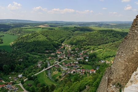 Cachtice Castle ruin from 13th century in Carpathians, Slovakia, Place associated with bloody countess, view of Visnove village from castle hill 免版税图像