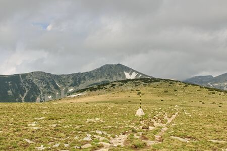 Panoramic view in Rila mountains, Bulgaria. Marked pathway.