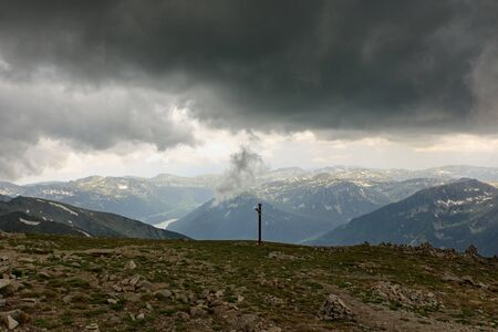 Panoramic view in Rila mountains , Bulgaria. Water dam in the valley. Dramatic clouds before storm.