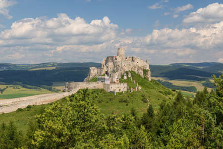 Medieval Spis castle (Spissky Hrad) in central Slovakia. Old historic castle ruins. One of the largest castle sites in Central Europe. Summer sunny day in nature.