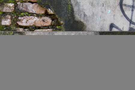 Exposed Brick and Graffiti on Weathered Wall Background Texture