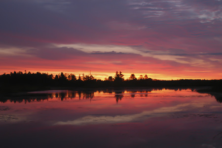 refuge: Multi-colored sunrise over a pond at Seney National Wildlife Refuge. Stock Photo