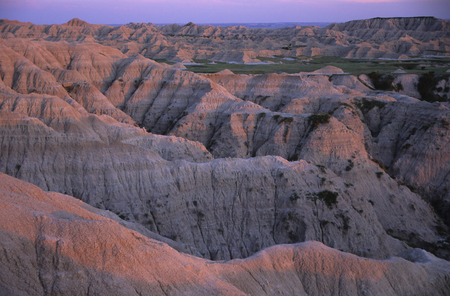 hardened: Rock formations at sunset in Badlands National Park, South Dakota.  The Rock formations are more like a hardened soil made from volcanic ash. Stock Photo