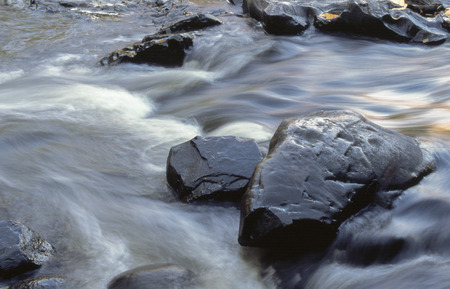 Water runs swiftly through the Dells of the Eau Claire River. Stock Photo