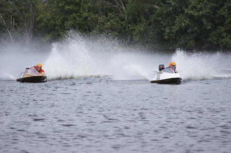 hydroplane: Boat races featuring small hydroplane boats powered by outboard motors. Stock Photo