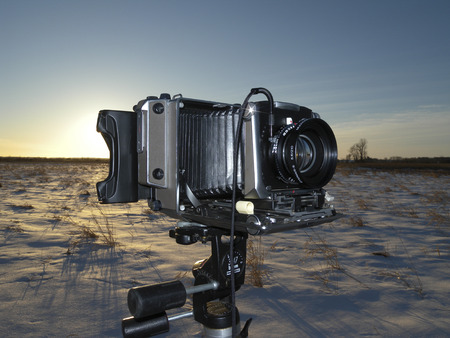 A large format camera (4x5) in a snowy field shortly after sunrise. Banco de Imagens