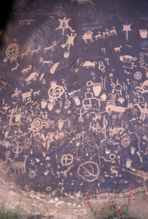 Over the centuries many Native American carved symbols and other art Ipetroglyphs) into the rock and desert varnish of Newspaper Rock outside Canyon Lands National Park in Utah. Stock Photo