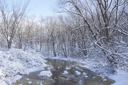 slushy: A stream turns slushy after a winter snowstorm. Stock Photo