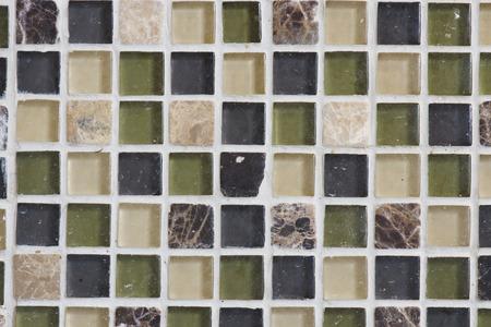 Het patroon van deze glazen en stenen tegels maken een goede back splash achter een aanrecht Stockfoto