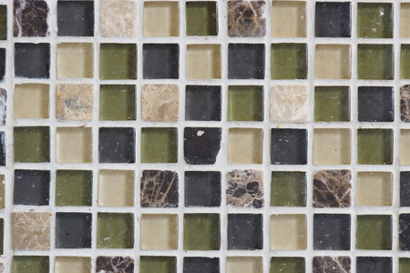 The pattern made by these glass and stone tiles make a good back splash behind a kitchen sink Stock Photo