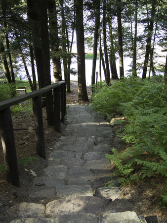 pine creek: Stone stairway leads down to a quite lake. Stock Photo