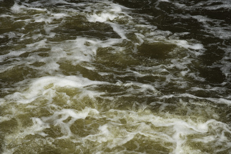 water stained: Brown-stained water in the rapids of a creek. Stock Photo