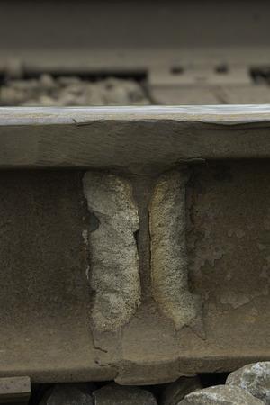 A weld holds two steel railroad tracks together. Banco de Imagens