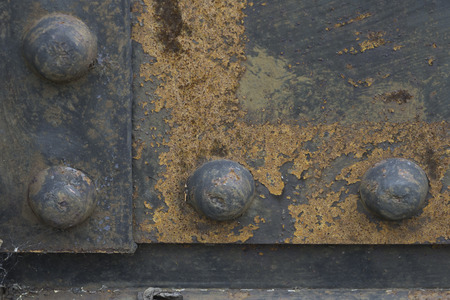 Rusty rivets and surrounding metals