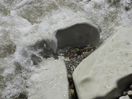 waves crashing: Waves crashing against white limestone rocks. Stock Photo