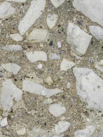 aggregate: Years of washing and wear by crashing waves have eroded and polished this old concrete aggregate. Stock Photo