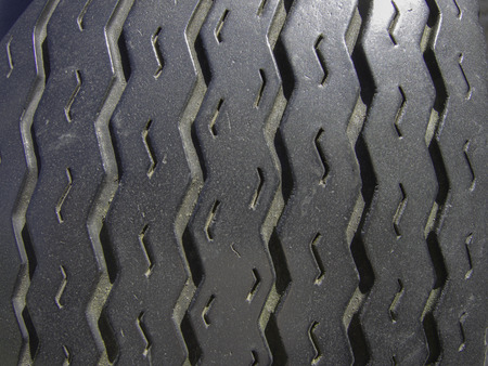 The zigzag patterns in the rubber of old tire threads provide traction for the tyres.