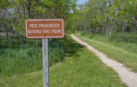 declaring: Sign declaring No Pets Beyon tis Point