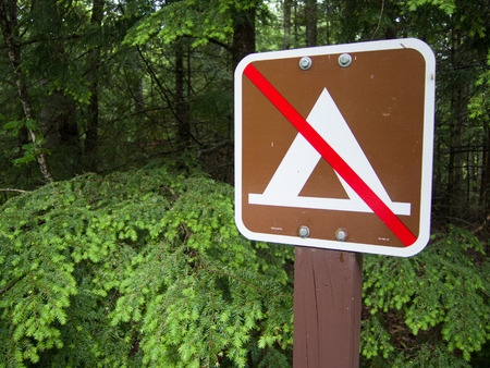 declaring: Sign declaring No Camping here.   Shows tent with a red line through it.