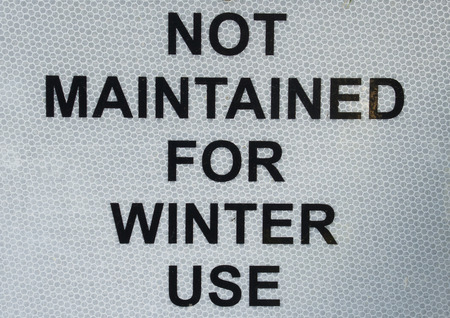 declaring: Sign on an observation tower declaring it is Not Maintained for Winter Use.  So watch out for ice.