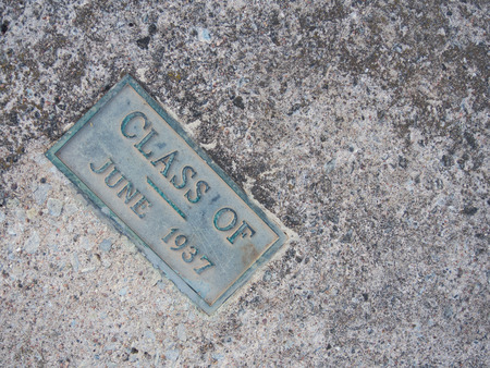 A weathered, green,  bronze plaque with plenty of patina celebrates the graduating class of 1936.