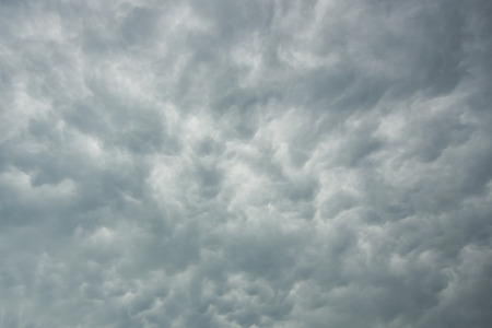 severe weather: High in the sky, clouds boil as a thunderstorm approaches.