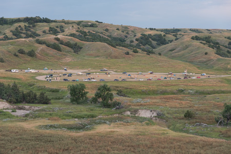 campground: Tents and campers are camping at the Sage Creek Campground, Badlands National Park, in the early morning.
