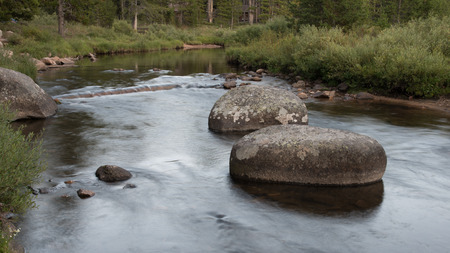 calming: Calming, peaceful scene of a trout stream and boulders with the water blurred, Bighorn Mountains, Wyoming.