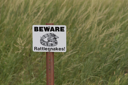 precaution: Sign warning hikers that rattlesnakes are nearby and they should take precautions.