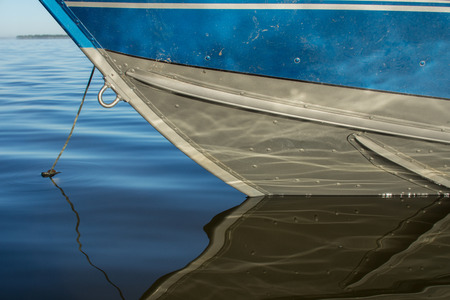 hull: Aluminum Fishing Boat Hull reflecting the ripples in the water. Stock Photo