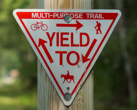 yield sign: Yield sign at a recreation trail for hiking, biking, horseback riding, and in the winter snowmobiling.