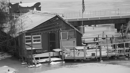 Old fishing shack and docks in winter.