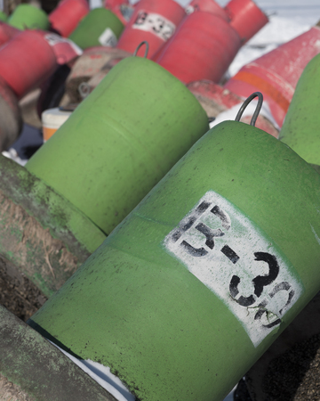 Buoys in snow, waiting for summer days.