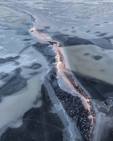 Crack forming on the very thin Ice of big Lake Butte des Morts. Stock Photo